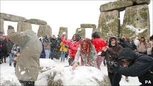 Snowball fight at Stone Henge on the winter solstice