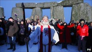 Druids led by Arthur Pendragon celebrate the winter solstice at Stone Henge