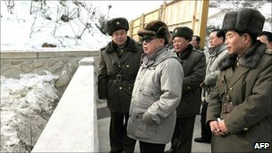 North Korean leader Kim Jong-il in newly released pictures of an undated visit to the Huichon youth electrical complex in Chagang Province