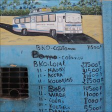 A picture of a bus and timetable on a wall, West Africa, 2010