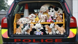 Toys in boot of police car