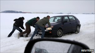 A car is stuck in a ditch near Amiens, northern France (23 Dec 2010)