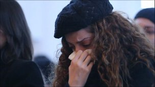 A woman weeps at the service in the Paris suburb of Montfermeil