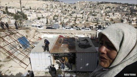Palestinians take apart their makeshift home in the East Jerusalem neighbourhood of Ras al-Ammoud, 21 December