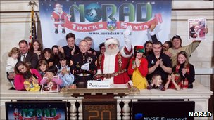 Santa Claus with Norad employees at the New York Stock Exchange
