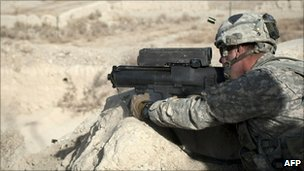 US soldier test fires in the Zheri district of Kandahar province on 22 December 2010