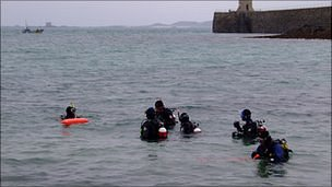 Divers in St Peter Port harbour on Christmas Day 2009