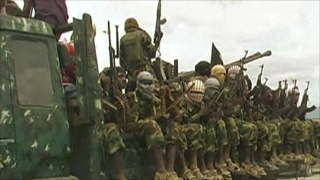 Somali fighters with guns