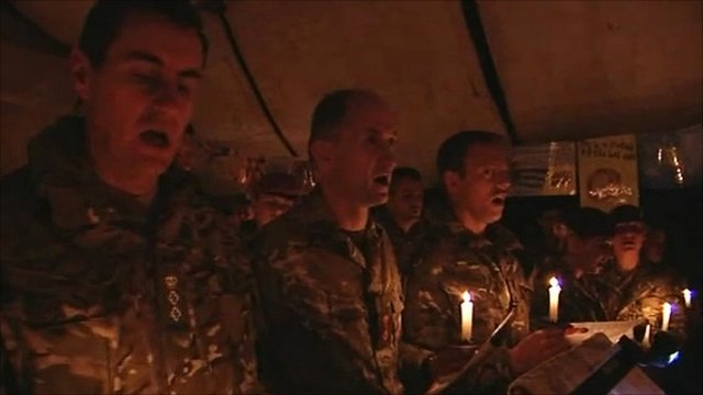 British soldiers singing carols by candlelight in Afghanistan
