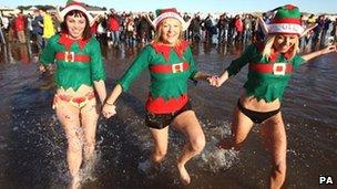 [L-R]: Anna Davies, Katrina Brown and Elinor Jones enjoy the annual Porthcawl swim