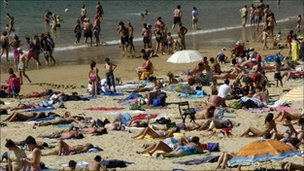 Sunbathers on a beach at San Sebastian in the Basque country, Spain