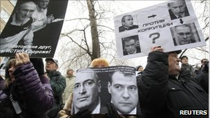 People attend a rally in support of Mikhail Khodorkovsky in front of the court building in Moscow
