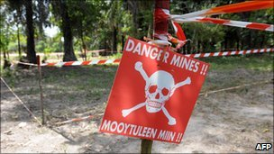 A sign warns villagers of a minefield in the southern Senegalese province of Casamance, 2009