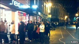 Hundreds queue outside a clothes shop in Queen Street before the doors open at 0500 GMT on sale day