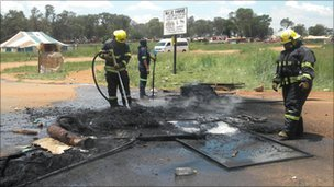 Firefighters put out fires in Bapsfontein (Tshepo Lesole/Eyewitness News)