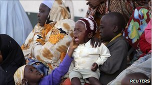 Jos residents in a camp for displaced people, 26/12