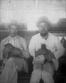 Anton Chekhov (right) with a friend cradling a Sri Lankan mongoose