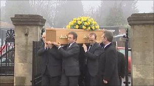 Coffin arriving