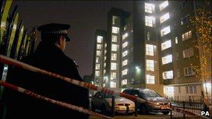 Police officer outside Heron House, on the Pelican Estate, Peckham