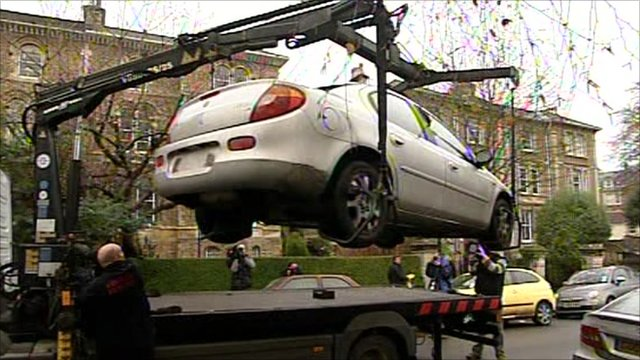 Car being lifted on to a truck