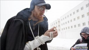 Belarus opposition activist Yan Logvinovich smokes a cigarette after being released from police custody, 29 December