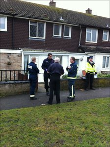 Fire officers and police outside the house