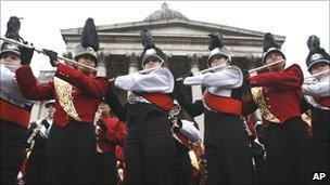 A marching band rehearses for the parade