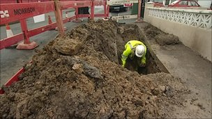 Man carries out water mains repairs