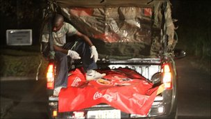 The body of a victim of a bombing in Abuja, Nigeria, is transported to the morgue, 31 December 2010