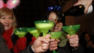 Partygoers share out champagne in London
