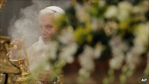 Pope Benedict XVI holds the aspersory as he celebrates a Mass in St. Peter's Basilica at the Vatican, Jan. 1, 2011