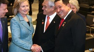 Venezuelan President Hugo Chavez (R) shakes hands with US Secretary Hillary Clinton, who stands between Colombian President Manuel Santos (L) and Chilean President Sebastian Pinera during Brazilian President-elect Dilma Rousseff's inauguration in Brasilia, Brazil