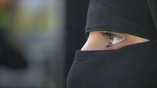 Syrian woman with face cover