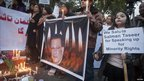 Supporters of Mr Taseer hold a candlelight vigil for him in Islamabad on 5 January