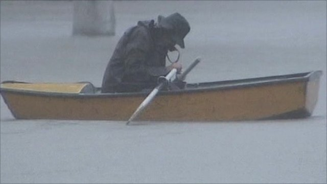 Man on boat in rain