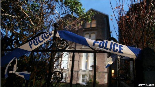 Police tape outside Jo's flat