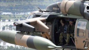 Australian PM Julia Gillard flies over flooded area of Queensland