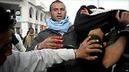 Injured protester is helped in Regueb, Tunisia (9 Jan 2011)