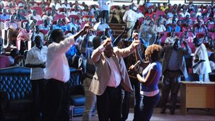 Sudan People's Liberation Movement leaders including secretary general Pagan Amum dance in front of crowds at the music competition