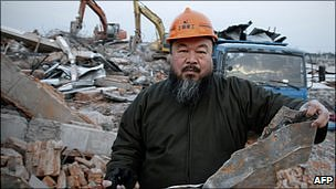 Chinese artist Ai Weiwei holds a piece of debris of his newly-built Shanghai studio after it was demolished