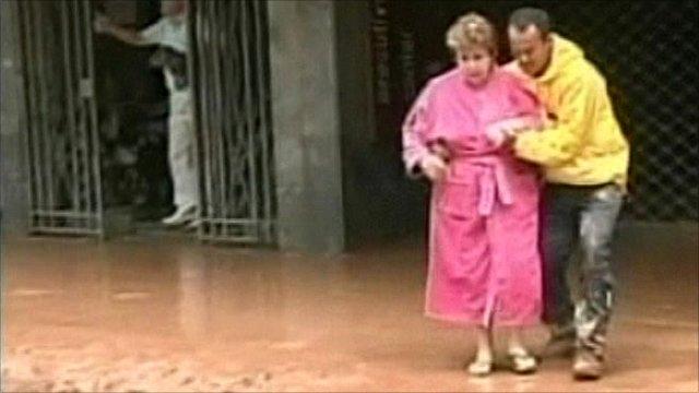 Woman helped through flood damage