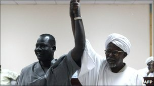 Sudanese Al-Amer Mokhtar Papo (R) a leader of the Misserya Arab tribe and his counterpart from the Dinka Ngok tribe, Sultan Qoual Dinq Qoual raise their hands after signing a peace agreement in the town of Kadugli north of Abyei on 13 January 2011