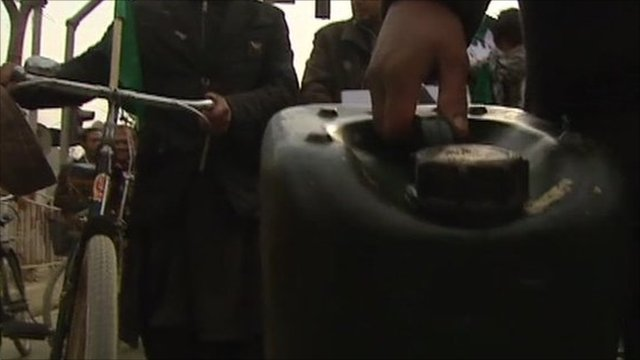 Man carrying fuel canister whilst on protest