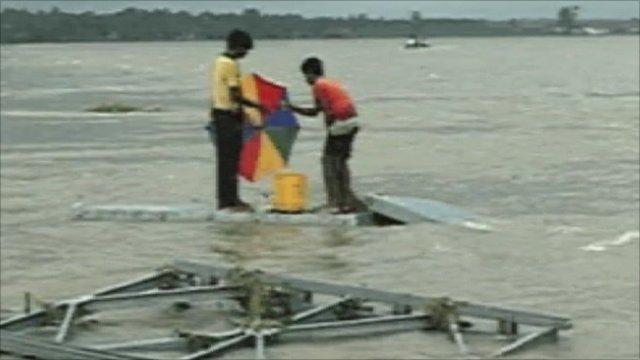 Sri Lankans standing in flood waters