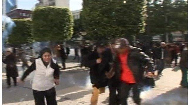 People fleeing tear gas in Tunis
