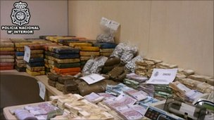Police display drugs and cash haul