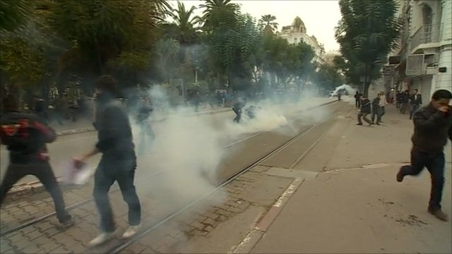 Protesters amid tear gas