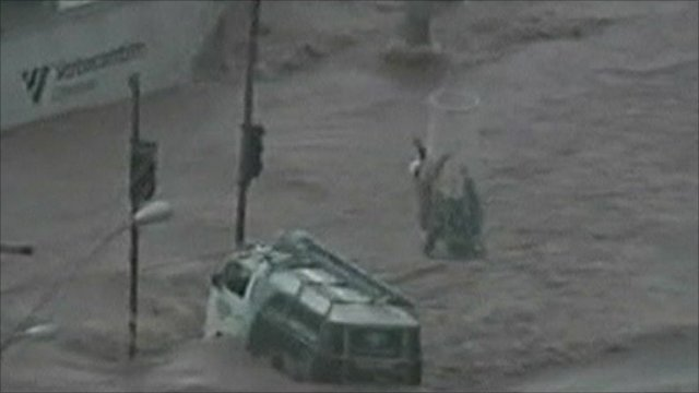 People being rescued from flooded bus