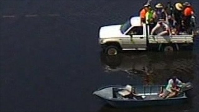 Small boat saves people stranded on truck