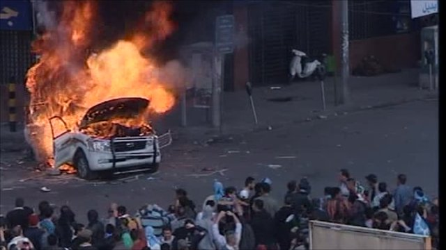 Protesters set a van on fire